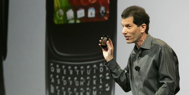 Image: Rubinstein, chairman and CEO of Palm, holds a new Palm phone during a news conference at the CES in Las Vegas